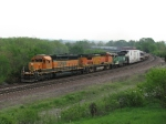 With a good older power consist, another westbound starts up the hill