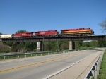 KCS 4704 leads two CP GEVO's south over US-30 with a BNSF grain train