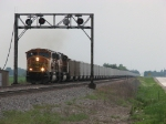 BNSF 9979 & 9899 lug a Consumers Power loaded train eastward