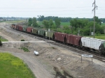 A grain train rolls north past Thirwell