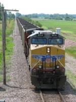 UP 6014 shoves south at the rear of CNAKI-12
