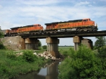BNSF 6073 & 5860 head east over Coal Creek with coal loads