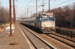 One of many Amtrak Regional trains   heads south  with a lonbger than usual consist account the thanksgiving holiday weekend