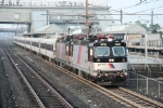 Doubleheaded ALP-44's lead a NY City bound train out of the Newark International Airport station