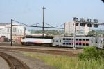 One of NJ Transit's newer PL42AC locomotives shoves an eastbound train towards its terminus of Penn Station in Newark