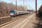 One of Amtraks HHP-8 locomotives flys through the station, DC-bound, oddly on a platform track