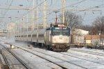 Washington-bound Metroliner Regional train kicks up the snow as it rushes past