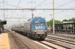 One of Amtrak's HHP-8 locomotives hustles a southbound Metroliner through the station