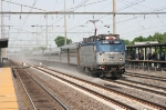 Train # 19, the Crescent, roars through led by AEM-7 # 943