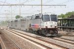 "An ex Amtrak  Genesis leads the ""Gambler's Express"" ACES train toward Atlantic City"