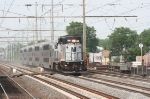 An NJT GP40-2 hustles 5 Bilevel coaches south/west in an equipment move