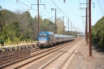One of Amtrak's HHP locomotives barrels south through the station into the afternoon sun