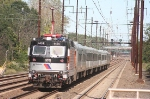 a northbound non-stop NJT move  rolls past with a more  conventional NJT consist