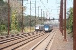Northbound ACELA passes a southbound Trenton-bound NJT local just north of the station.