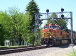 BNSF 4428 Passes Underneath a Signal Tower Near the Diamond