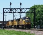 Two Different SD70M's & A Small Geep Lead A Manifest Under A Quad Set of Red Signals