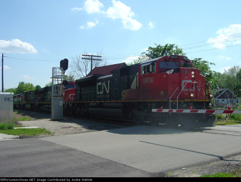 CN 8804 leads a northbound across Oakland Avenue