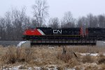 CN 8931 leads a northbound over the low bridge