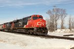 CN 2277 highballs Highway K with a southbound