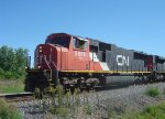 CN 5676 is northbound just past the diamonds