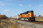 BNSF 9324 follows the string of coal gons northward