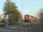 CN 8938 leads a northbound off the siding approaching Highway K