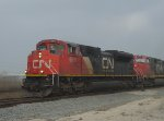 CN 8868 leads M338 elephant style with a Dash 9