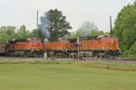 BNSF SB loaded grain meet with NB empty coal train