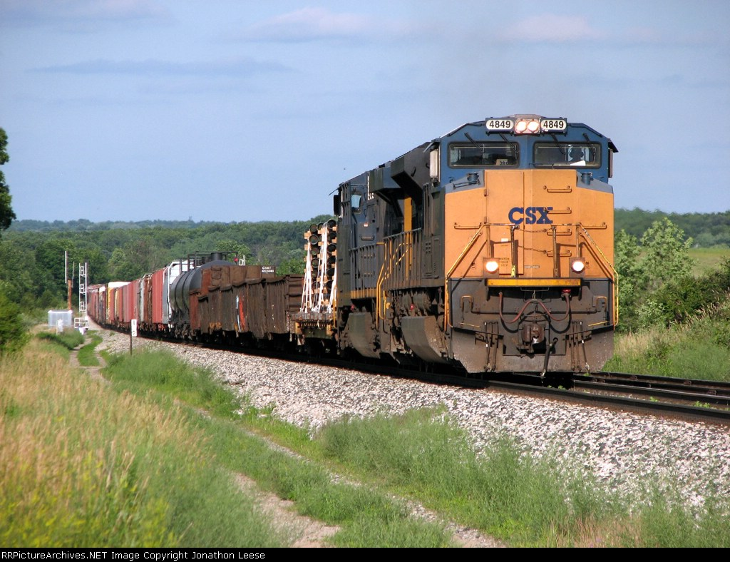 CSX 4849 leads Q327-03 up the hill