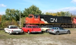 CN 5623 passes some classic cars