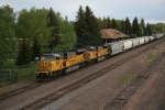 Westbound UP freight passing the old Laramie station