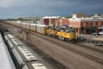 Eastbound UP freight passing Laramie's historic district
