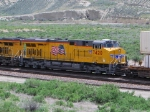 UP 7420 rolls east behind UP 7762 as they climg the grade towards Rock Springs, Wy. with  a Z-train