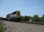 CSX 8638 leads 6 gondolas towards North East from Erie