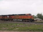 BNSF 7528 leads a WB mainfest and waits for an EB manifest in the siding