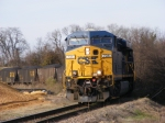 CSXT 734 leads a loaded coal train into Downtown