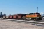 BNSF 4406 Heads out wit a few Ballast Hoppers