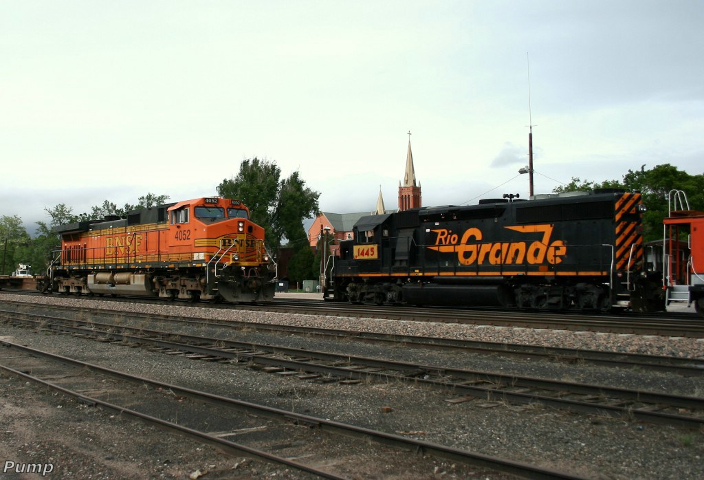 Southbound BNSF Bare Table Flat Train and the UP Local Locomotive