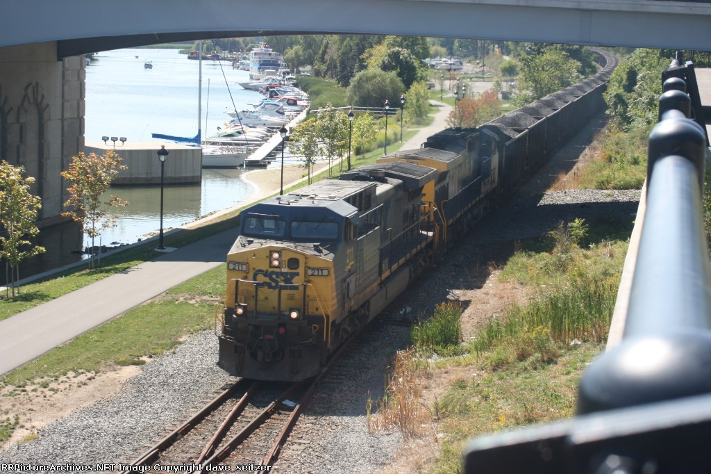 CSX 211 leads a Northbound coal train headed for the now closed Russell power plant