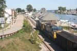 A pair of CSX AC44CW's run a coal train up to the RG&E Russell Station. The old freight depot & abandoned Hojack swing bridge can be seen in the background.