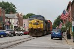A pair of AC44CW's lead an inter modal train down the middle of Main St.