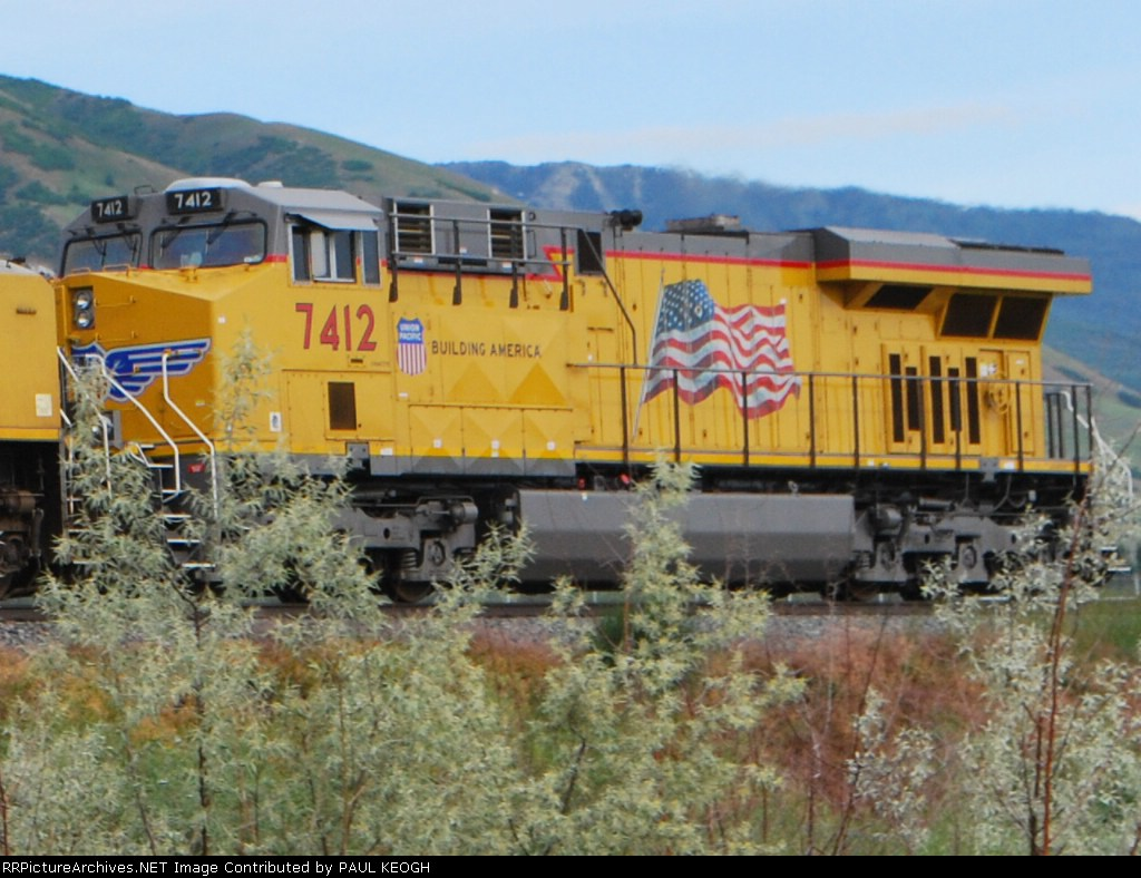 UP 7412 rolls north towards Ogden, Utah as a rear DPU on a eastbound Z-train.