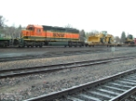BNSF 6929 SD40-2 leading a front-end loader
