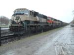 BNSF 9820 SD70MAC on a snowy and rainy day