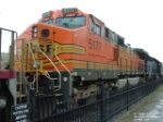 BNSF 5177 C44-9W towering above park fence