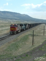 BNSF 8223 SD75M hauling coal drag westbound
