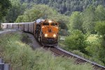 287H701 winds its way along the Canisteo River and Rt 119 with 54 empty auto racks and 5119 feet of train.