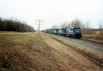 CR 6643 leads an Eastbound mixed freight.