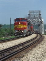 ATSF 568 leads the westbound #199 train across the Des Plaines River bridge