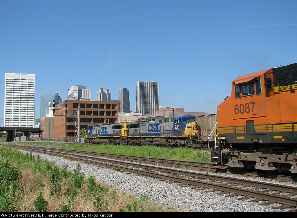 CSX Q614 passes Scherer coal train at Spring